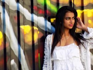 Portrait of Indian Woman Near Street Art